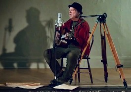 Neil Young plays 'Comes A Time' from an empty theatre in his hometown