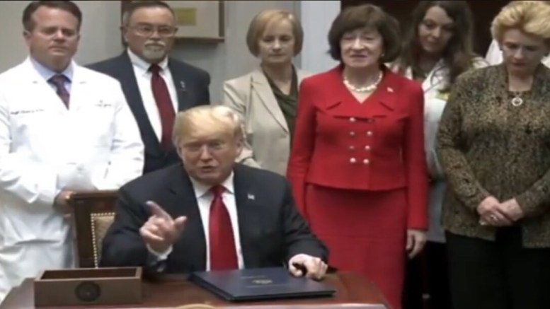 President Trump during medical bill signing. Photo credit to US4Trump with a screen capture.