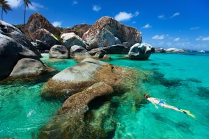 Young,Woman,Snorkeling,In,Turquoise,Tropical,Water,Among,Huge,Granite