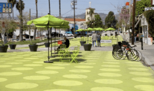 The NACTO Urban Street Design Guide instructs engineers how to design pedestrian plazas, like this one in Los Angeles. Image: ##http://inhabitat.com/sunset-triangle-plaza-las-first-pedestrian-plaza-conversion-is-now-open/## Inhabitat##