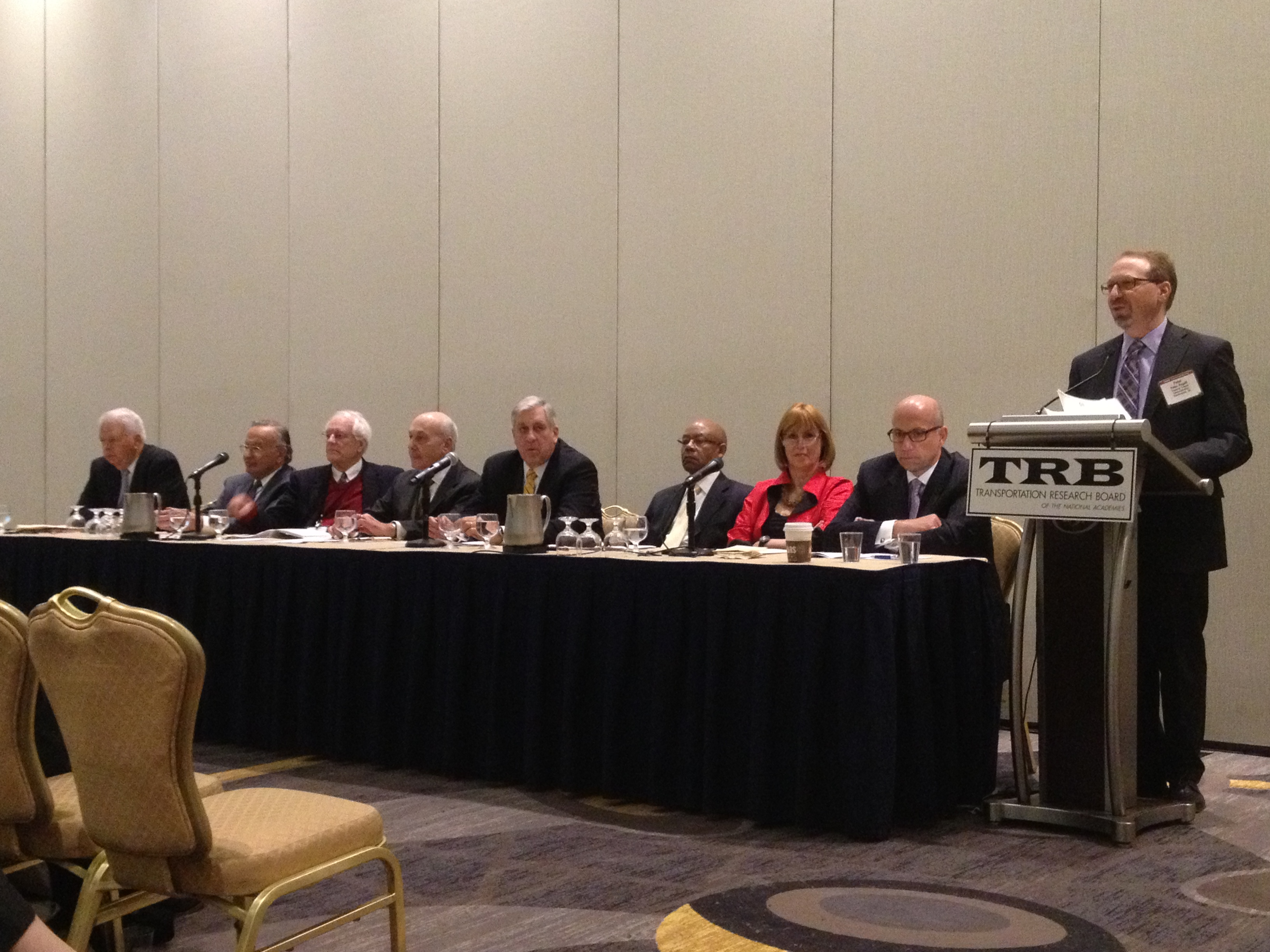 Former UMTA and FTA administrators, from left: Frank Herringer, Bob Patricelli, Ted Lutz, Al DelliBovi, Brian Clymer, Gordon Linton, Jenna Dorn, Jim Simpson, and current administrator Peter Rogoff at the podium. Photo: Tanya Snyder