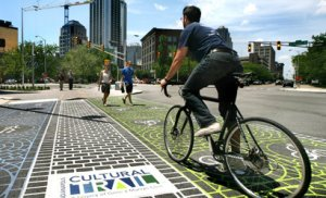 The Indianapolis Cultural Trail is one of many game-changing, innovative projects that the TIGER grant program has helped create. Under U.S. DOT's bill, TIGER would become a permanently authorized program with $5 billion to spend over four years. Photo: ##http://www.urbanindy.com/2010/11/18/pedestrianizing-downtown-indianapolis/##UrbanIndy##
