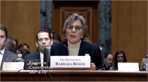 Sen. Barbara Boxer testified today before the Senate Finance Committee, asking members to come up with $18 billion a year for her spending plan.
