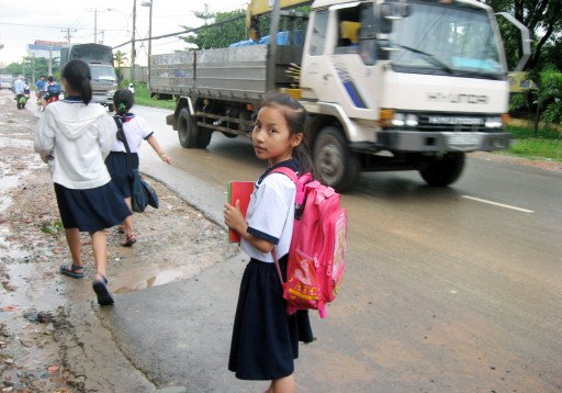 """Please give us a safe route to school."" This picture of a 9-year-old girl in Vietnam helped catalyze street improvements. All photos courtesy of Safe Streets Worldwide"