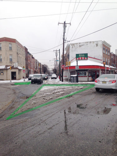 This Philadelphia intersection was in need of some pedestrian improvements, as the patterns in the snow helped illustrate. Image: This Old City
