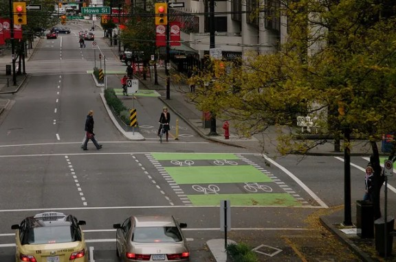 The separated bike lane on Dunsmuir Street in Vancouver received the first generation of the city's intersection treatments. Photo: ##https://www.flickr.com/photos/pwkrueger/5133829565/in/photostream/##Paul Krueger/flickr##