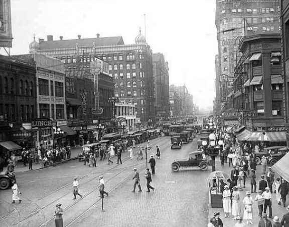 A hundred years ago, it wasn't taken for granted that the main purpose of a street was to let automobiles go fast. Photo via Peter Norton