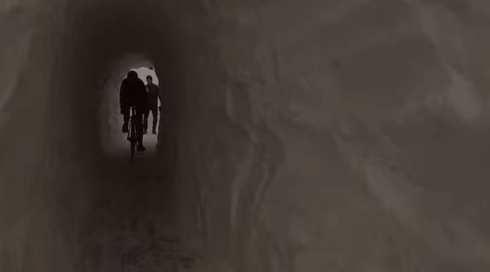 This 40-foot snow tunnel, built by Boston cyclists, made a biking and walking path useful again. Image: Dragonbeard on Youtube