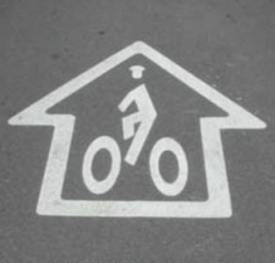 The original sharrow, developed by a Denver bike planning in the early 1990s. Image: The Bicycle Story