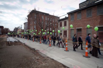 Streetcar supporters marched the length of the route this weekend, rallying for the continuation of the project. Image: ##http://www.urbancincy.com/2013/12/hundreds-of-streetcar-supporters-rally-in-over-the-rhine-as-new-mayor-council-are-sworn-in/## Urban Cincy##