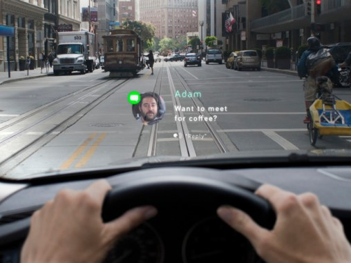 The new dash-mounted technology system Navdy proposes making texting while driving easier. Image: Navdy