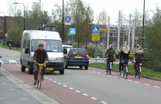 """Advisory bike lanes,"" like the one in the Netherlands, allow drivers to drive in the bike lanes only if there are no cyclists there. Photo: Bike Portland"
