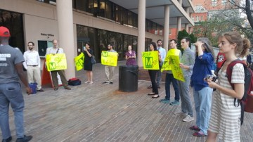 Protestors demonstrate against late-night service cuts outside a Metro board meeting last week. Photo: Greater Greater Washington