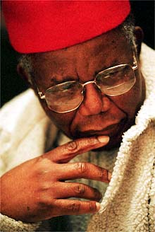"Famed Nigerian writer and author of ""Things Fall Apart"" Chinua Achebe pauses as he listens to well wisher's during a 2 day conference and celebration of his 70 birthday a Bard College.  Friday November 3, 2000.(Will Waldron Photo)"