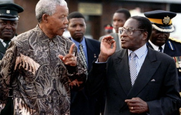 "Mugabe attacks Mandela for ""being too saintly, too good"" to White South Africans"
