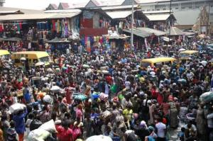 People gather at Balogun market two days before Christmas in central Lagos