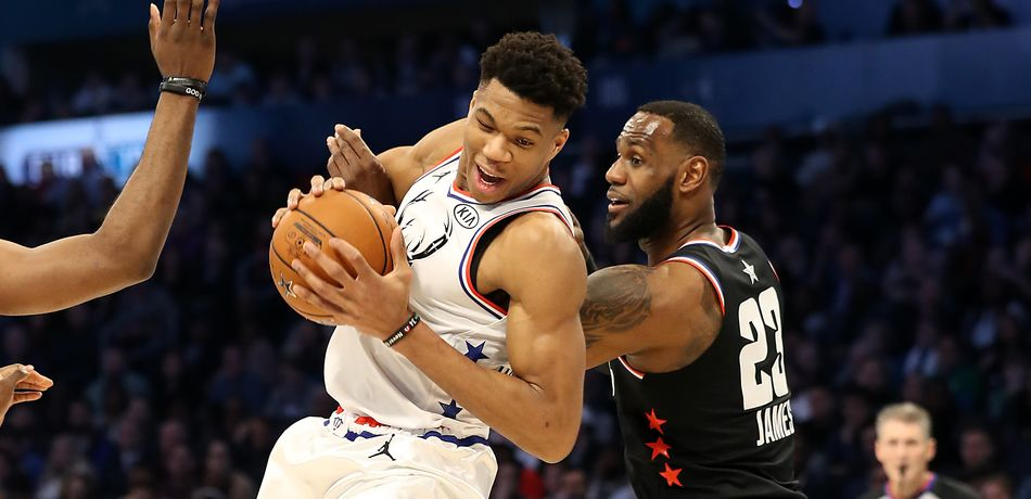 Giannis Antetokounmpo is defended by LeBron James during the 2019 NBA All-Star Game.
