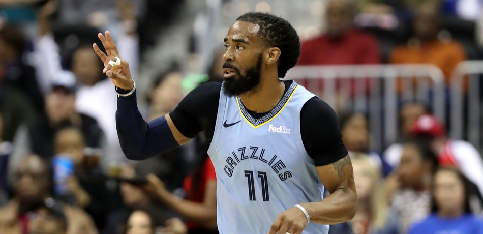 Mike Conley #11 of the Memphis Grizzlies celebrates after hitting a three pointer against the Washington Wizards in the first half at Capital One Arena on March 16, 2019 in Washington, DC.