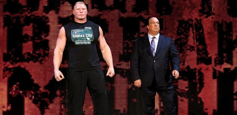 Brock Lesnar and Paul Heyman prepare to make their entrance on an episode of WWE Monday Night Raw.