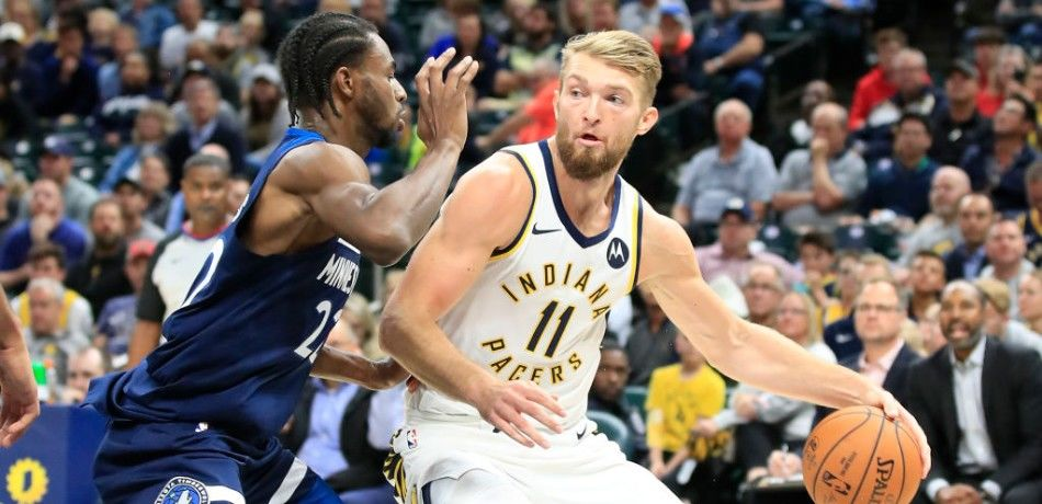 Domantas Sabonis (R) of the Indiana Pacers posts up against Andrew Wiggins (L) of the Minnesota Timberwolves.