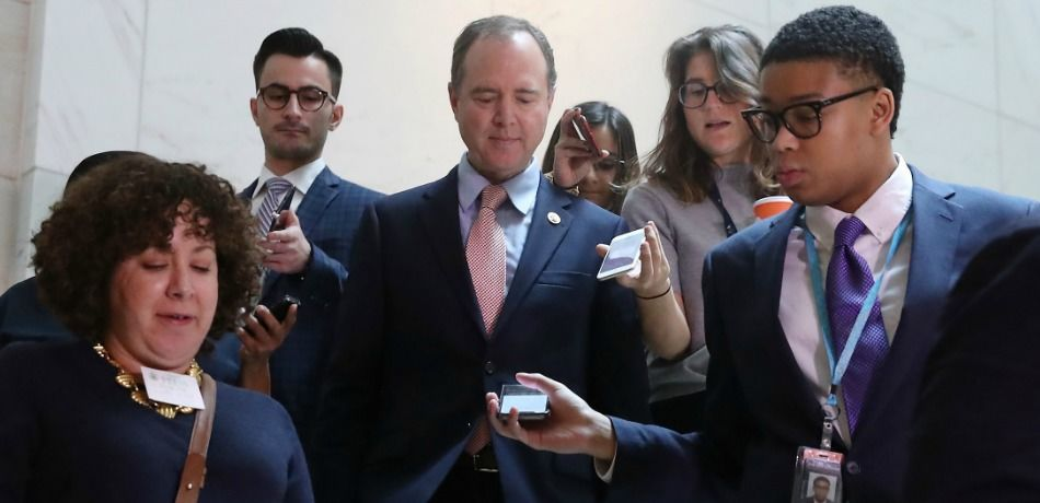Rep. Adam Schiff is trailed by reporters as he walks to a closed-door deposition on Capitol Hill.