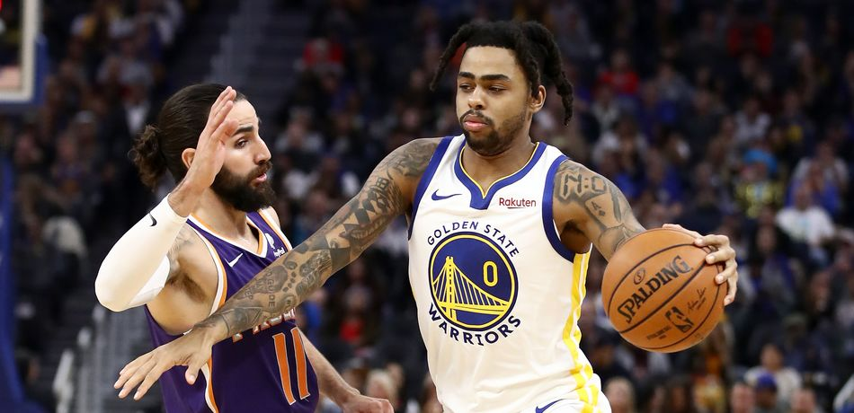 D'Angelo Russell #0 of the Golden State Warriors dribbles past Ricky Rubio #11 of the Phoenix Suns at Chase Center on October 30, 2019 in San Francisco, California.