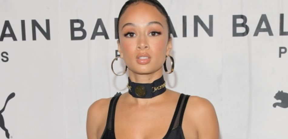 Draya Michele wears a black outfit.