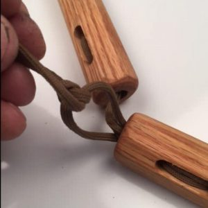 """Tie the open ends to a double knot. """"box knot"""""""