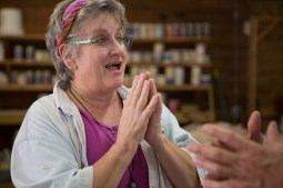 Beth Weitz, potter, describes the effects on her fingertips of working with clay over so many years. Muddy Evolution, Apalachicola, FL. / ©2017 Audrey Horn / www.usathroughoureyes.com