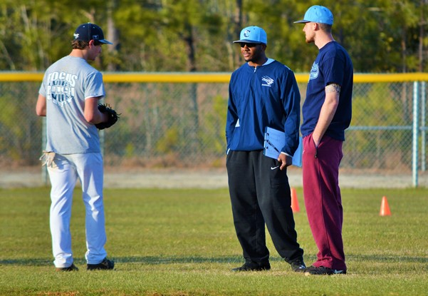 """Former Cougars Jamel Paige and Mark Blankenship, shown giving advice to current player Lucas Bell, have returned """"home"""" and will be volunteering as assistants this season. Photo by Cindy Crosby"""
