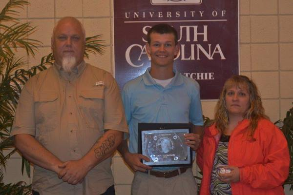 Cody Thompson pictured with Mr. and Mrs. Kyzer