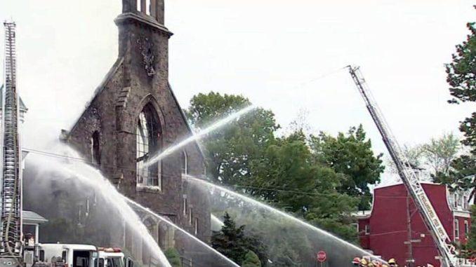 Philadelphia firefighters are battling a second alarm Philadelphia Tacony church fire that has sent heavy black smoke to the sky