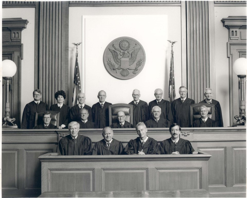 Group portrait of Oregon U.S. magstrate judges (front row), Ninth Circuit judges (seated back row) and district court judges (standing), June 4, 1992.
