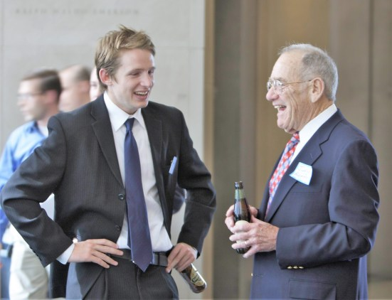 A young attorney and Judge Redden enjoy a laugh at the 2008 Bench and Bar Social. Photo by Owen Schmidt