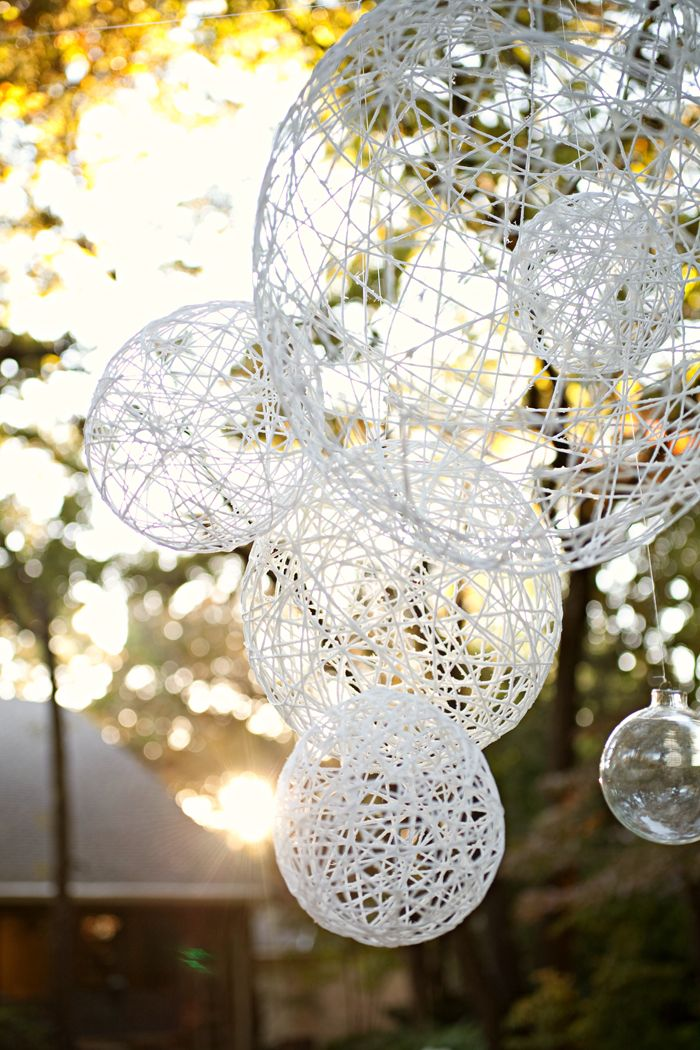 22 beautiful simple diy lighting fixtures ideas 17 twine globes displayed in the garden and lit up at night by christmas lights aloadofball Images