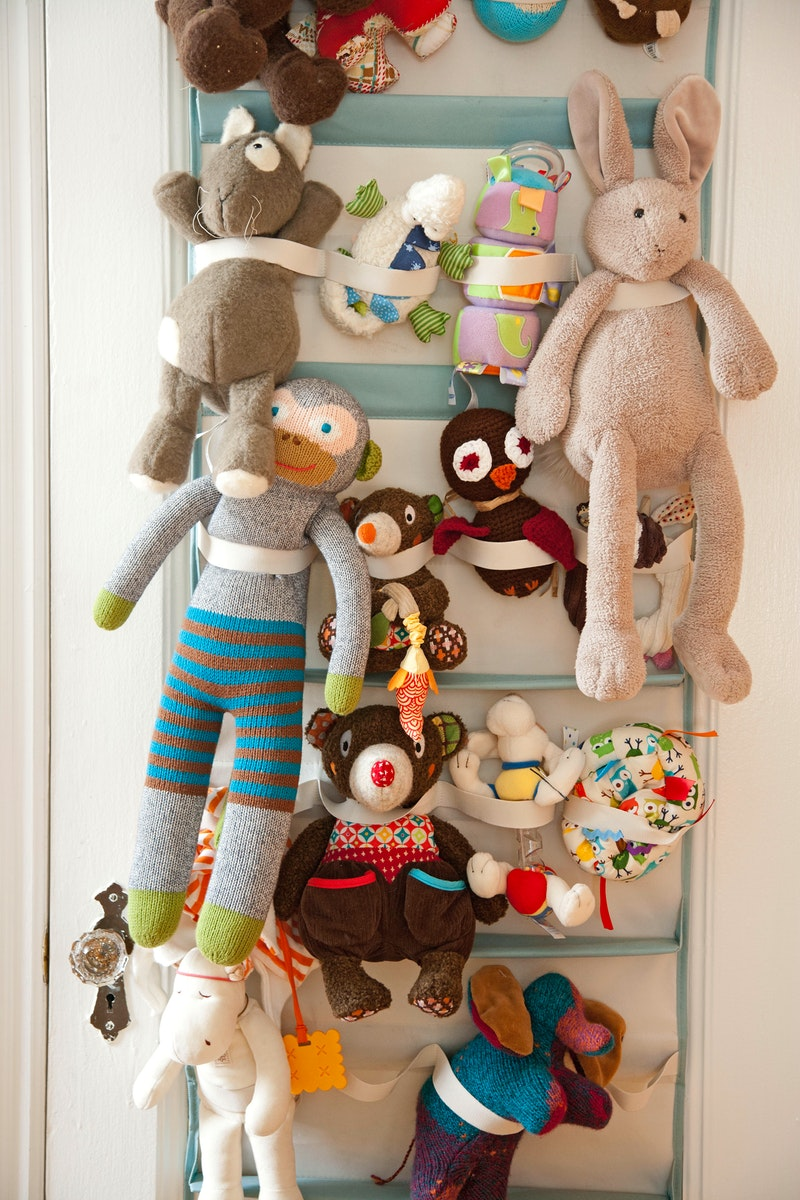 Hang a toy organizer on the door & Top 40+ Stuffed Animal Storage Ideas To Consider - Useful DIY Projects