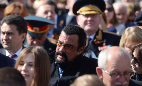MOSCOW, RUSSIA - MAY 9:  In this handout image supplied by Host photo agency / RIA Novosti, Actor Steven Seagal attends the military parade to mark the 70th anniversary of Victory in the 1941-1945 Great Patriotic War, May 9, 2015 in Moscow, Russia. The Victory Day parade commemorates the end of World War II in Europe. (Photo by Host photo agency / RIA Novosti via Getty Images)