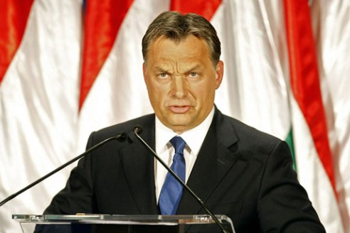 Hungarian Prime Minister Viktor Orban delivers his speech during the meeting the Professiors' Bathyany Group in Budapest on September 7, 2010. At home at least, the popularity of Hungary's new Prime Minister Viktor Orban, who secured an historic two-thirds majority in general elections in April, remains unbroken. With the government marking its 100th day in power opinion polls show support for the charismatic leader still at an astonishing 64 percent, making the 47-year-old the country's most popular premier ever. AFP PHOTO / FERENC ISZA