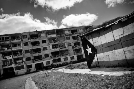 A Cuban national flag is seen painted on a shack in Alamar, a large public housing complex in the Eastern Havana, Cuba, 5 February 2009.