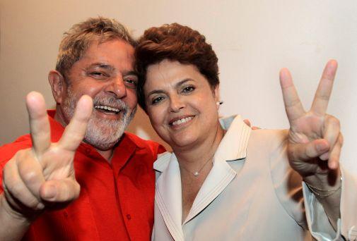 In this photo provided by Brazil's Presidency, Brazil's President Luiz Inacio Lula da Silva, left, and Brazil's newly elected leader Dilma Rousseff, make a sign of victory, at the Alvorada palace, in Brasilia, Brazil, Monday, Nov. 1, 2010. (AP Photo/Brazil's Presidency, Ricardo Stuckert) NO SALES