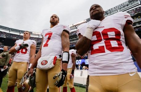 kaepernick standing for anthem in 2014