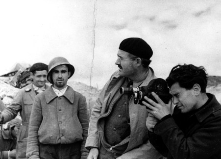 EH5408P c.1937-1938 Ernest Hemingway with a film cameraman and two soldiers during the Spanish Civil War, 1937-1938. Photographer unknown in the John F. Kennedy Presidential Library and Museum, Boston.