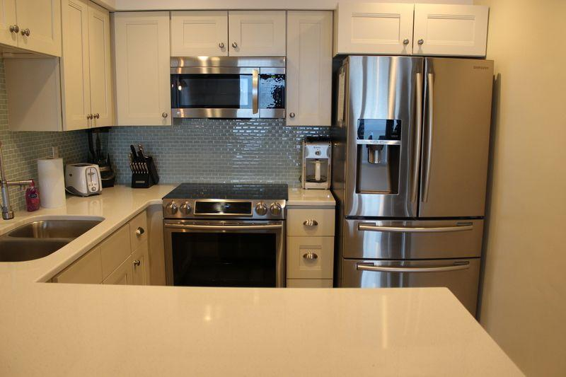 solid wood shaker kitchen cabinets stainless steel faucet with pull down spray vanilla - rta