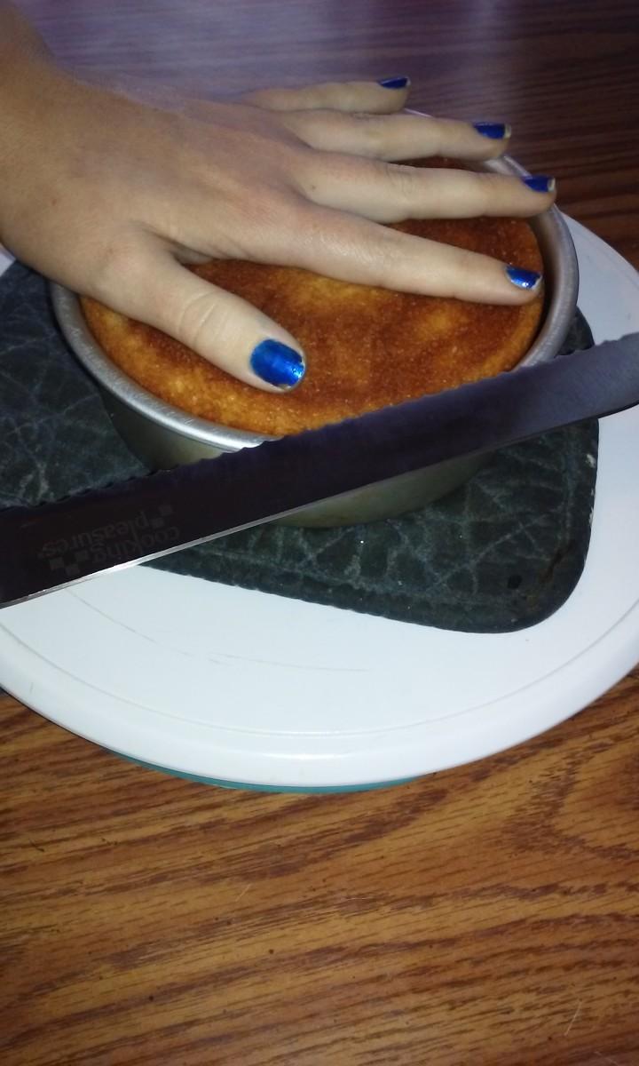 Cake Decorating Basics How To Level Your Cakes Delishably