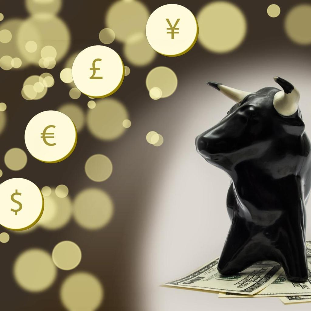 Bull with different currency signs