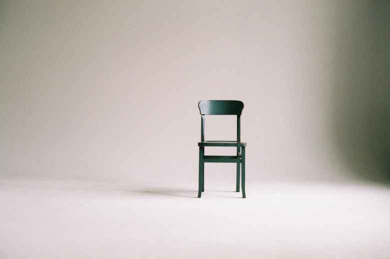 green wooden chair on white surface