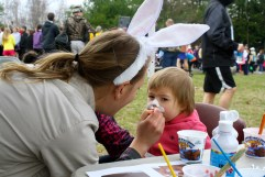 A child gets her face painted by Janet Gorman, a member of the Maine Conservation Corps-Americorps for Rachel Carson National Wildlife Refuge. Credit: USFWS