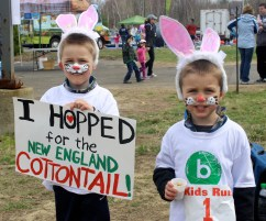 These two Bunny Hoppers got their faces painted, number stickers stamped with a bunny track, and put on a pair of rabbit ears for a photo! Credit: USFWS