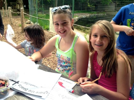 Helia Silveira and Ellie O'Donnell work on the piping plover chick craft. Credit: USFWS