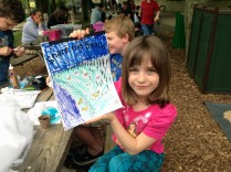 """Allegra Breitkopf holds up her colored """"Share the Beach"""" with shorebirds activity book. Credit: USFWS"""